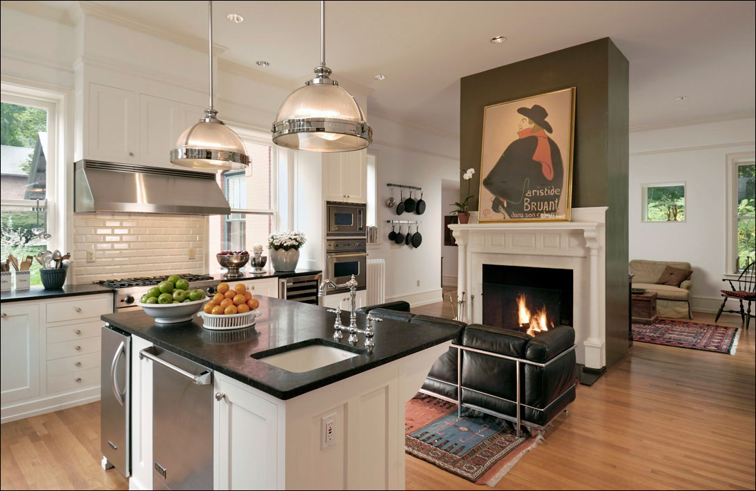 residential kitchen with fireplace sitting room